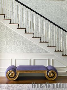A vibrant custom bench in the entry. Design: Pat Healing. housebeautiful.com. #entry #purple #bench #wallpaper