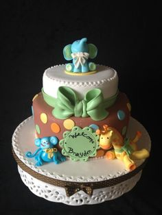 Quilted Baby Jungle Animals Cake - Baby Shower cake for a little boy. Jungle Animal theme with monkey, giraffe and baby elephant topper and big bow. Baby Shower Cakes For Boys, Baby Boy Cakes, Baby Shower Themes, Shower Ideas, Elephant Baby Showers, Baby Elephant, Elephant Theme, Giraffe, Safari Cakes