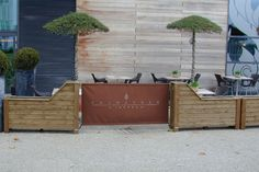 We created a beautiful outside seating area for a popular bar using bespoke timber barrier planters. Branded canvasses were attached along sections of the barriers to project a professional image.