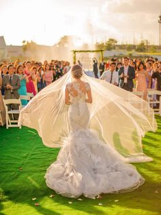 "Why We Love It: Breathtaking! We love how the sunlight hits the bride's flowing veil as she makes her way down the aisle.Why You Love It: ""The wow factor here is off the charts!"" —Diana E."