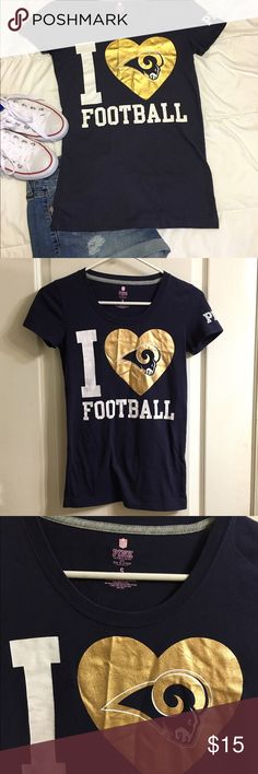 """PINK LA Rams Shirt Alright, LA friends... You will have some LA Rams watch parties, tailgates and game-going days in your near future! This is one of my only pieces that says """"Rams"""" without """"St. Louis"""". Great condition, cute little tee! The heart is a metallic gold, just a little wrinkled from being folded up. Should fall out with a steamer. PINK Victoria's Secret Tops Tees - Short Sleeve"""