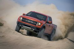 Red  Ford SVT Special Vehicle Team Raptor F-150 off-road truck