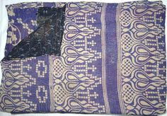 Kantha quilts are made from vintage Indian saris pieced together. This one would look gorgeous on my blue French bed. #DeborahBeau