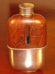 Beautiful Edwardian Period Vintage Heavy Glass Silver plate Crocodile Leather Hip Flask Made In England Circa 1910  A beautiful Edwardian period Crocodile leather covered heavy glass antique hip flask. The removable drinks cup is marked made in England, it is not engraved so could easily be engraved with a loved ones name or initials making the flask a fine commemorative gift. The flask is in overall good condition with no chips or cracks, and the cap fits securely and is fluid proof…