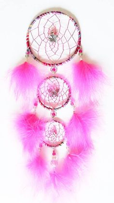 3 Tiered Dream Catcher - made with wool yarn, meal charms, glass beads and pink marabou feathers. Hoops are 4, 3, 2.5 inch. You can see all my work at https://www.facebook.com/pages/Dreamscape/471890606282556