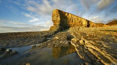 Nash Point on the Glamorgan Heritage Coast shows the amazing stratigraphy of sedimentary rocks and water-eroded coastline. Nash point by Tim Wood