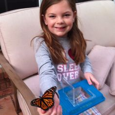 My grand-daughter letting a butterfly go that she had in butterfly cage...