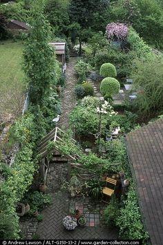 long narrow garden arranged in rooms