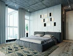 Chambre à coucher grise avec une tête de lit fusionnant avec le mur décoré de…