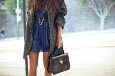 blue & black striped dress, baggy jacket.
