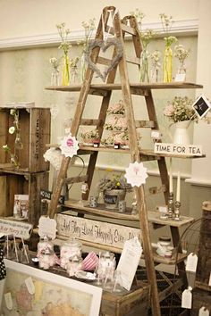 """Vintage Ideas This ladder display is the perfect visual to show how to """"pyramid"""" in your store. More - Today we're throwing it back with some adorable vintage wedding ideas. We're loving everything about this rustic wedding inspiration today. Ladder Display, Ladder Decor, Wooden Ladder, Ladder Shelves, Window Shelves, Design Shop, Flower Shop Design, Display Design, Store Design"""