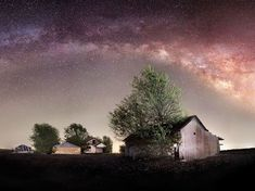 Picture of an abandoned farm under the night sky outside Bartlett, Texas