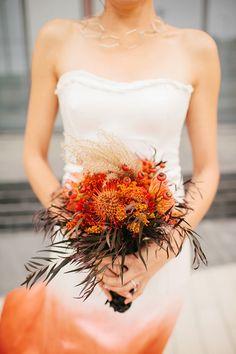 orange wedding bouquet - photo by Jordan Voth Photography http://ruffledblog.com/modern-orange-and-black-wedding-inspiration #weddingbouquet #floweres #bouquets