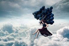 Girl floating in sky with balloons in concpetual photography image by Jimmy Bui