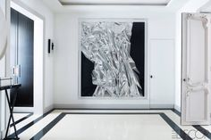 Dramatic black and white entrance hall with mixed media work by Anselm Reyle // Champeau Wilde Design, Paris - ELLE DECOR Apartment Entrance, Entrance Foyer, Entrance Design, Entry Hallway, Parisian Apartment, Paris Apartments, Apartment Design, French Apartment, White Apartment