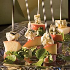 Ham & Cheese Skewers - Thread blue cheese wedges, apple slices, cubes of deli ham, and fresh watercress leaves onto wooden skewers for a super fast, super easy appetizer