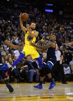 Stephen Curry of the Golden State Warriors looks to pass around Jeff Teague of the Minnesota Timberwolves at ORACLE Arena on January 25 2018 in...