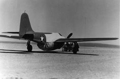 To maintain secrecy, prototype Airacomets were towed to and from the flightline with a fake propeller and a cover over the engine exhausts and intakes. (U.S. Air Force photo)