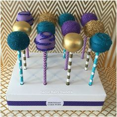 Peacock color inspired cake pops for a birthday party.