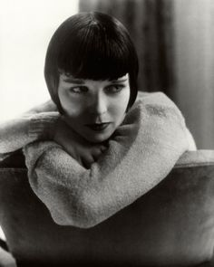 The 20th-century ingénue Louise Brooks broods beneath her iconic cropped cut. Photographed by Edward Steichen for the January 1929 issue.