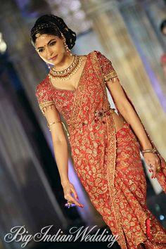 red bridal sari by #taruntahiliani