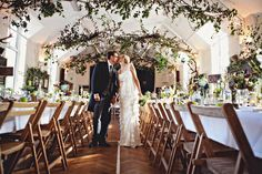 hanging branches and greenery above the wedding feast