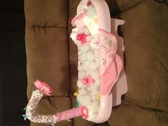 Baby shower gift full of diapers and bath stuff