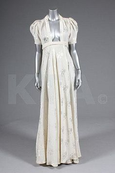Ossie Clark ivory damask `Bridget' dress, early labelled `Quorum', with plunging neckline, wrap-over skirt with knife-pleated side panels Biba Fashion, Seventies Fashion, Vintage Fashion, Vintage Dresses, Nice Dresses, Vintage Outfits, 1960s Dresses, Amazing Dresses, Ossie Clark