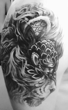 Beautiful Tattoo of a creative lion - cover up of a teenager tribal ... black&white #inkt #dierentatoeage #tattoo #lion #cover #lionshead #black #realistic
