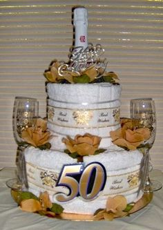 Wedding Anniversary 3 Tier Towel Cake Towel and nappy cakes - amazing designs 50th Anniversary Decorations, 50th Wedding Anniversary, Anniversary Surprise, Wedding Towel Cakes, Themed Gift Baskets, Raffle Baskets, Money Cake, Nappy Cakes, Towel Crafts