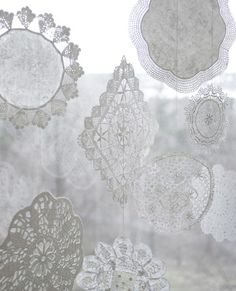 stiffened doilies hung as snowflakes