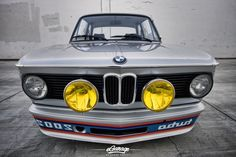 BMW 2002 Turbo from an era when it was cool to show mirrored text on the spoiler so drivers in front of you could read the name of the car that was about to pass them in their rear-view mirror:)