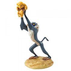 Enchanting Disney Rafiki presents the newborn lion cub, Simba on Pride Rock. This A King is Born Rafiki Simba Figurine is made from resin. Simba And Nala, Lion King Simba, Stickers Pirate, Le Roi Lion Disney, Walt Disney, Figurine Disney, Classic Disney Characters, Disney Enchanted, Recipes
