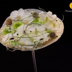 Wedding bouquet  with the Phalanopsis and beautiful gerbera's  on a base made from oyster shells with adhesive techniques - give you a light shape that is easy to carry and has almost no weight.