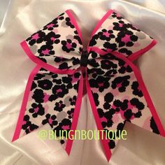 Pink, black, and white cheer bow. BlingNBoutique.