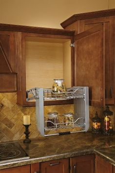 Rev-a-shelf allows you to reach the items on the top shelf easily. -Courage Kenny Rehabilitation Institute