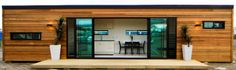 #EcoContainer This eco conscious, compact NZ Bach created from a 40 ft shipping container clad in cedar and black powdercoated aluminium joinery with tinted green glass. From the clever architects at Cubular NZ.