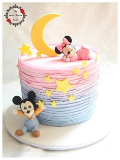 A baby Minnie and Mickey themed cake for a christening today. Getting the faces just right on the babies is quite tricky, I must have made half a dozen mouths for each before I was happy!:
