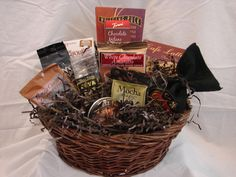 Wake Up Call - Gift basket assembled with your favorite coffee lover in mind. WithBreakfast Blend Coffee,Wolfgang Puck Coffee, Capri Dark Roast Coffee,Mocha Latte,Cappuccino,Java Pop,Chocolate Covered Espresso Beans,Pirouline Cookies,Biscotti,Wafer Cookie and aRendez Vous Coffee Candy Tin,this collection is sure to get themmoving! Local Cincinnati delivery or nationwide shipping available. From Gifts Of A Different Stripe. $35
