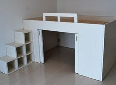 Raised bed with storage underneath