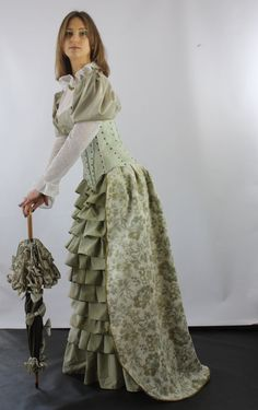 Long elegant Victorian skirt with frills in front and back train. Looks beautiful both with or without corset. Perfect for refined occasions and even for a wedding! Frills made of delicate, light green fabric. Back train made of heavy, thick, pearl color fabric with gold and green flower pattern. Back trains hem lines finished with gold bias binding. Both fabrics are mix of cotton and polyester.  Two types: 1. With bows: Length: 107cm/42inch Waist: 66cm/26inch 2. Without bows: Lengt...