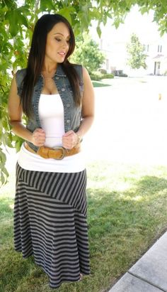 Curvy girl - Denim vest, white tank, tan belt and striped maxi skirt