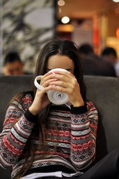 everything about this makes me HAPPY- the sweater, her long hair, the giant mug of coffee :)