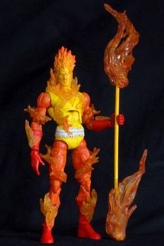 this is a marvel legends Firelord Custom Action Figure he was made by figure realmer jmao he used a fantastic four movie human torch body, ronan series human torch head forearms, shins, feet and one hand the other hand was the movie masters prototype suit batman his staff is a shish kabob stick with cut flamed shape plastic blister card packaging and hot glue happy pinning