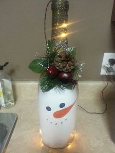 Wine bottle with snowman