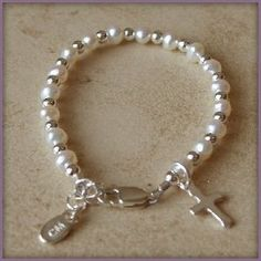 Made in Usa! First Communion Bracelet Sterling Silver Girls Childrens Jewelry, Freshwater Pearl Bracelet Features an Adorable Little Cross. Perfect for Christmas, First Communion, Easter, Graduation, Sunday Dress, Christening or Birthday. Hail Mary Gifts. $29.99. Made in USA!. Save 17% Off!
