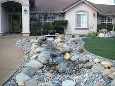 Create Front Yard Landscaping With Rocks — Extravagant Porch and Landscape Ideas Landscaping With Rocks, Front Yard Landscaping, Backyard Landscaping, Landscaping Ideas, Backyard Ideas, Flagstone Path, Gravel Patio, Fire Pit Using Bricks, Inexpensive Landscaping