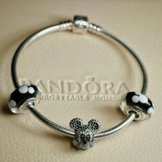 PANDORA Disney Mickey charm bundle PANDORA Disney Mickey 3 charm bundle.   Includes:  1 Pandora limited edition Sparkling Mickey Portrait charm and 2 Pandora Classic Mickey glass charms.  All NWOT and hallmarked S925 ALE.  BRACELET NOT INCLUDED.  Pandora box not available. No trades please.  Thanks and check out my closet for more great items! PANDORA  Jewelry Bracelets