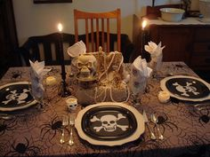 adult pirate party themed table. Think fishnet burlap red bandannas eyepatch is gold