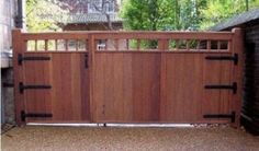 Wide wooden driveway gate and attached pedestrian gate